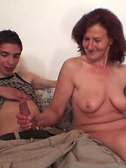 Redhead granny serviced two younger guys