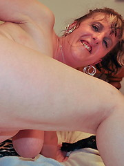 Appetite mature woman licks her round tits and enjoys with toy