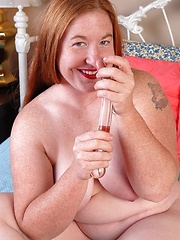 Redhead chubby mom lubes sex toy and begins hot action