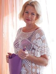 Diana Douglas masturbates on her sofa after work