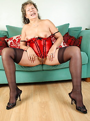 Large mature woman playing with her pussy