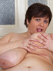 Huge breasted mature lady getting naughty