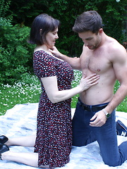 Horny British housewife doing her toy boy in the grass