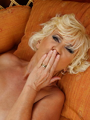 Horny blonde mature woman getting naughty in her garden