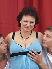 Chubby mature lady having a threesome
