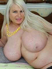 Huge breasted British housewife getting naughty