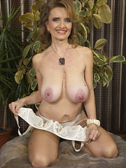 Horny big breasted mature lady playing alone