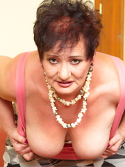 Naughty mature slut playing with her dildo